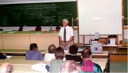Ron Dunkley addresses the WFNMC meeting in Seville, Spain, in July 1996. Professor Dunkley was elected President of WFNMC at this meeting, where a Constitution was approved for the first time.