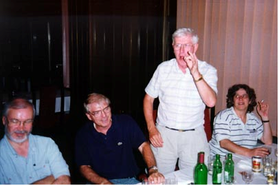 Ron Dunkley addresses the orhestra, giving his next request. Accompanied by Larry Davidson (Canada), Ron Scoins (Canada) and Patricia Fauring (Argentina), Bulgaria, 1994